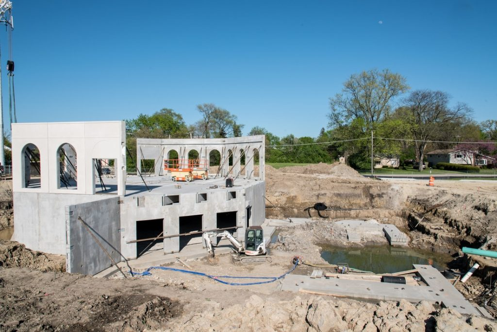 May 5, 2017: The first floor precast wall panels of the prayer hall are installed on top of the basement panels. Viewed from the southwest (opposite of qiblah direction.)