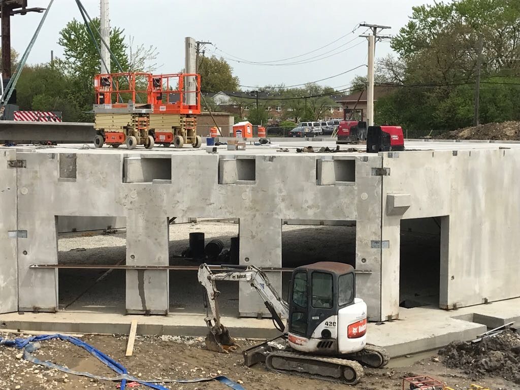 May 3, 2017: The four door entrance area in basement hall is depicted on the second day of precast panel installation